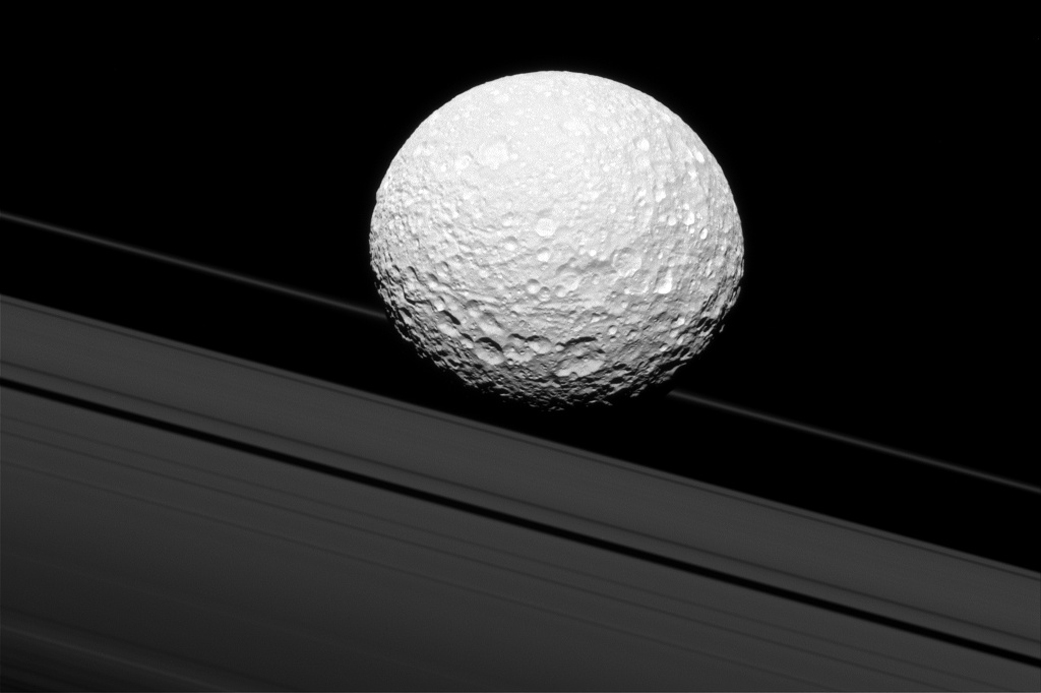 Cassini image demonstrating an illusion of Mimas crashing into Saturn's Rings